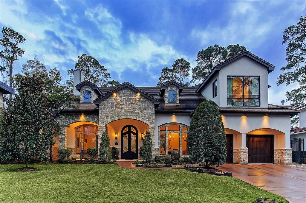 Centrally located 5 min. from Downtown and 12 min. to Medical Center, this 5 BR home sits on nearly half an acre w/unobstructed views of the Hogg Bird Sanctuary & River Oaks Golf Course with no back neighbors. Inside, panoramic windows & high ceilings maximize the prime location. Rustic touches meet modern luxury as evident in the stunning cathedral beamed ceiling & natural stone accent walls of the great room. Renovated in 2018, the kitchen features separate Sub-Zero cabinet-front 3' refrigerator & freezer, & full Viking stainless steel appliance package, including elite 60'' range. Extravagant touches are found through the home; formal dining w/barrel vault ceiling, parlor w/dual aquariums, bar, wine room, oversize game room, theater, fully-equipped separate guest quarters/casita. All large bedrooms feature tray ceilings, en suite baths, & walk-in closets. Owner's suite w/separate sitting area, patio access, & views to the waterfall pool/spa, stepped yard, & unparalleled site.