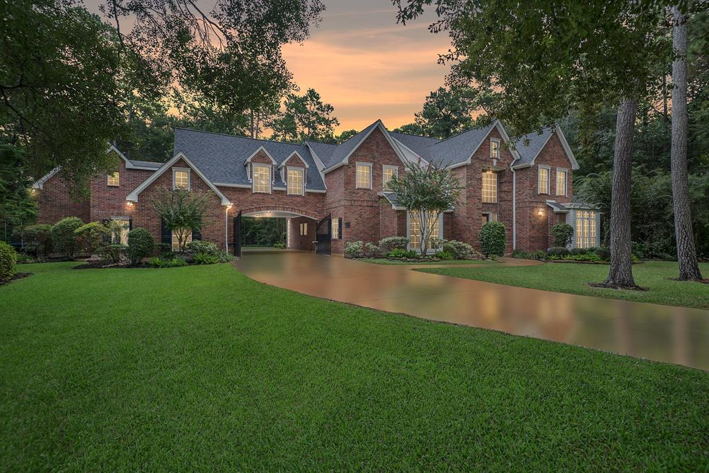 Beautiful Custom Jeff Paul estate home on 1.25 park-like acres! Very private with forest behind! High ceilings, abundant built-in storage & recent updates will make this property an easy choice Upscale appointments throughout! Updated kitchen features granite countertops & upscale appliances! Stone & real hardwood flooring! Handsome paneled Study. Generous Master Suite has spa-like bath w/ whirlpool tub and 2 custom walk-in closets! High ceilings, abundant built-in storage & recent updates will make this property an easy choice. Enjoy early morning or evening on the upstairs deck! Unmatched resident's association! 3-car detached garage with finished large Media Room area above! 2-car porte cochere.  NEW: Roof, HVAC, Water Heaters, Carpet, Master and secondary bathrooms updated. NEVER FLOODED!!  Easy access to 45 and HWY 99.  You have to see this one to see everything this amazing house has to offer!