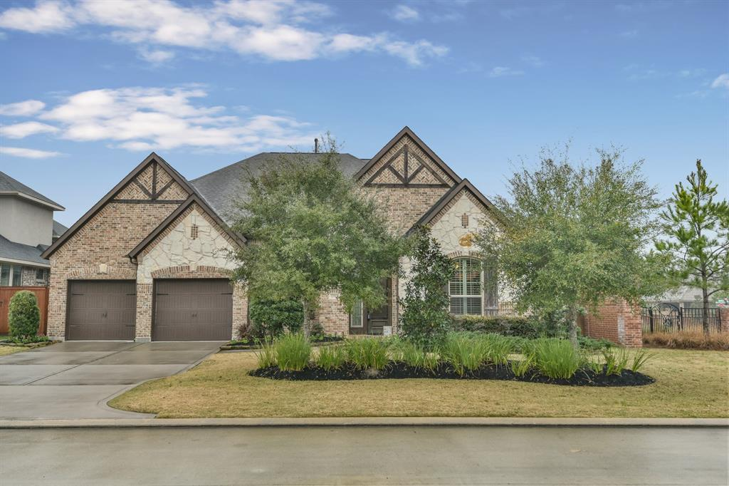 """RARE 1.5 story Trendmaker Home on CORNER LOT! The gated community of Benders Landing Estates has convenient access to downtown via Grand Pkwy (99) & Hardy Toll Road while providing a secluded, country setting. This """"barely lived-in"""" home features popular wood-look tile in common areas, designer kitchen finishes w/exotic granite counters, sleek tile backsplash, stainless steel appliances, decorative, dark metal stairs w/wood handrails. An oversized island w/counter bar opens to living area-great for entertaining! Take entertaining upstairs to the game room w/half bath-a space w/endless possibilities! A leaded glass front door, tall foyer, bay windows in breakfast & Master bedroom are a few of the architectural details that add character. Rich cabinetry, exotic granite, split vanities, oversized frameless glass shower & deep soaking tub transform the spacious master bath into your own private spa. A covered patio w/OUTDOOR KITCHEN doubles livability factor! DOES NOT BACK TO RAYFORD RD!"""