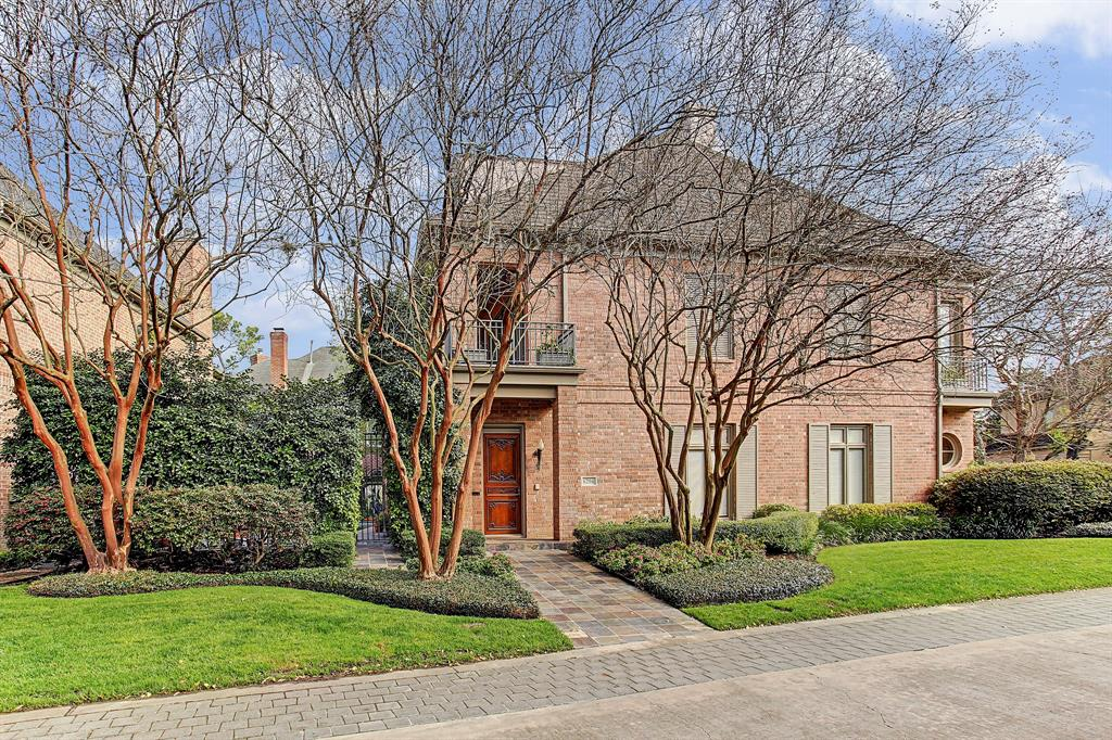 This beautiful brick home, located on a corner lot in the prestigious Arlington Court neighborhood, was designed by Bruce Monical. The large formal entry opens to a spacious living room and dining room. Lots of wall space for art and beautiful views from these spaces to the private yard and patio with a sparkling lap pool and koi pond. The galley kitchen with a breakfast bar opens to the family room with a fireplace and built-ins. A small bedroom and bath on level one as well as a wet bar and wine storage closet. Stairs and an elevator to the upper levels. Master suite on the second floor has great closet space and a large bath. Picture windows and doors open to a covered porch overlooking the yard and pool. A beautiful library is located on this level with walls of adjustable book/display shelving and access to a full bath. Additional bedroom with a private bath, a home office and the utility room also on level two. Large crafts room and storage on level three. A fine home.