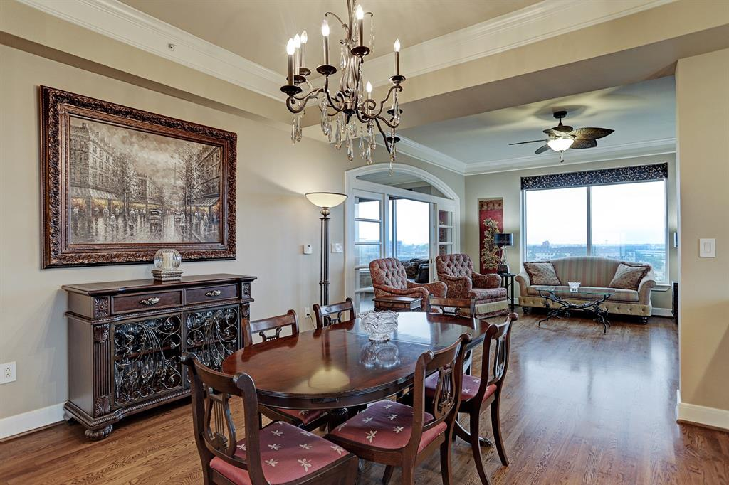 Stunning, highly sought-after NE corner location at The Royalton! Perfect for entertaining, this impeccable condo boasts an open concept floor plan and breathtaking views of Downtown and Buffalo Bayou. Expansive living room features beautiful hardwood floors throughout, built-in entertainment center, cozy faux fireplace, floor to ceiling windows, and an intimate balcony with upgraded tile. Formal dining room flows graciously from kitchen to living room and complements the incredible downtown views. The converted master bedroom offers extended living space with sliding French doors and excellent natural light. Exceptional building amenities include 24-hour Concierge Service, Valet, Wine Cellar, Coffee and Juice Bar, Theater Room, Conference Room, Fitness Center, Pool, Spa, Guest Suites, Dog Park and Limo Service on weekends. Convenient to downtown, and upscale restaurants. Walk to Whole Foods, The Dunlavy and much, much more.  A stunning home in the sky!