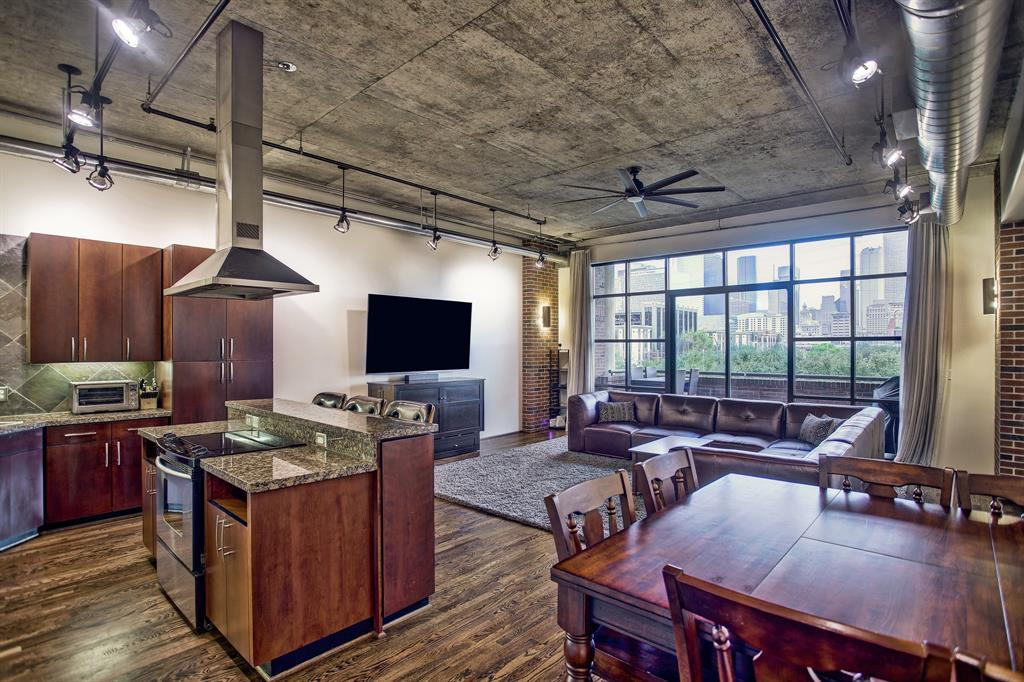 Looking for a loft with a stunning downtown view and close to all the action? Look no further! Experience the East Downtown Urban Lifestyle near exciting venues such as Minute Maid Park, Toyota Center, and the Dynamo Stadium. This cool EADO loft in The Stanford is across from the EADO/Stadium Metrorail stop and BBVA Compass Stadium, and it is just a short walk to Minute Maid Park and Discovery Green. This unit offers expansive and unobstructed views of Downtown from the living room and balcony and features tall ceilings, floor to ceiling windows, fresh paint throughout, recently re-finished oak hardwoods & stained concrete flooring, modern lighting, huge walk-in custom built closet, whirlpool tub, chef's kitchen, granite countertops, and new stainless steel appliances just to name a few. The building features enclosed landscaped grounds with private pool and lounging areas as well as secured entry. This unit includes 2 parking spots.