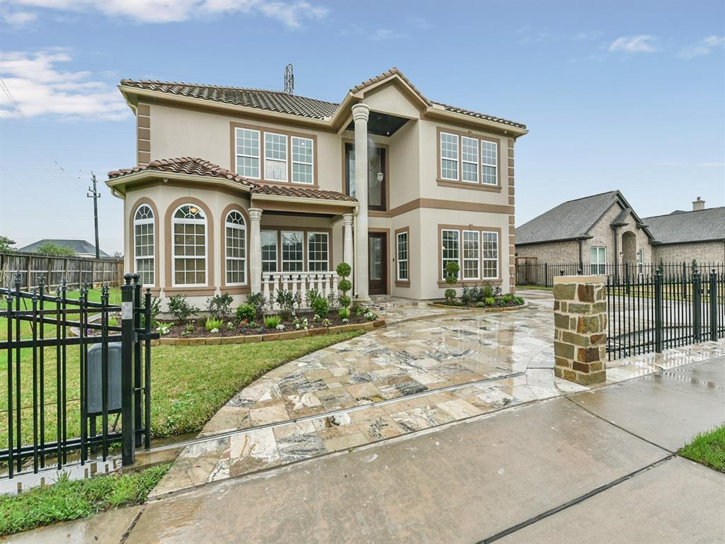 Exquisite home in Pearland Golf Course Community. Spanish style with elegant entrance, french mahogany front door with Cantera stone columns inside and outside, high ceilings, two master suits with full baths(jac.tub and sep. shower). Granite counter-tops in the office and bathrooms, hand made metal stair rails, clay tile roof, wood floors. Custom built dream gourmet kitchen with granite counter-tops with custom cabinetry. Game room upstairs with it's own private balcony. Beautiful 2 story detached apartment with 1/2 kitchen,living, laundry room, 1 master bedroom and 2 bathrooms.