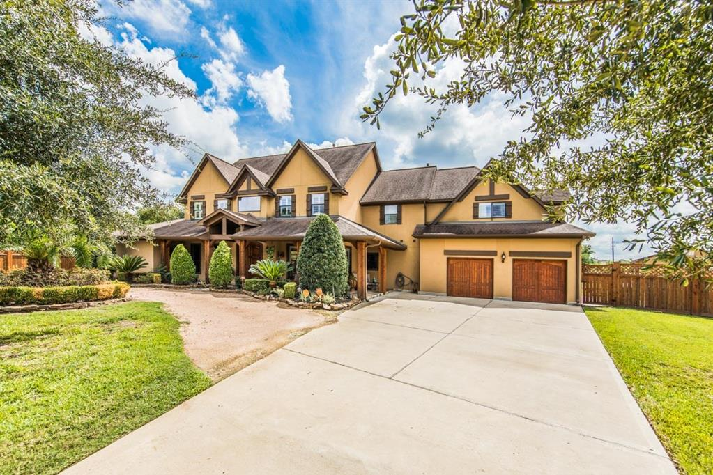 One of a kind--Beautiful 5/4/2 Custom Ranch style home on 1.63 acres that is truly a one of a kind piece of property in Katy! 27 ft. high cathedral living room ceiling w/a gorgeous view of the amazing backyard.  The master closet is an amazing must see.  The 2 bedroom/1 bath pool house (approx. 1,000 sq ft) opens up to the heated sparkling pool w/hot tub, water fall fire pits, veranda, covered porch, and sitting area w/fireplace. Zoned to the highly acclaimed Katy ISD.  Have your very own oasis and backyard playground in the middle of the city with a country feeling..  No HOA, No MUD.  Taxes are 2.08%. Commercial Grade security camera system w/ monitor, intercom system at front gate, lights along one side of the back of the property, two separate surround sound systems, 220 voltage x 3 in backyard, and much more.  This home has NEVER FLOODED.