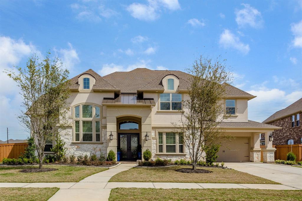 Stunning Castello plan situated on a 20,893 sq. ft. lot with gorgeous lake views features a grand two-story foyer with raised study with French Doors, formal dining room, wide-planked hardwoods & ceramic tile throughout first floor, plantation shutters and spacious family room with corner cast stone gas log fireplace. Amazing island kitchen has granite counters with mosaic lantern tiled back splash, S/S appliances including a 6-burner cook top, double ovens, 2 walk-in pantries, breakfast bar and breakfast room. Master suite with sitting area and master bath has  a whirlpool tub, dual headed shower, quartz vanities and a fantastic walk-in closet. Upstairs has a game room with kitchenette and covered balcony with lake views, media room, study nook and 4 bedrooms with 3 full baths. Oversized backyard has gorgeous lake views, plenty of room for a pool, 19',x11' covered patio w/gas stub and secondary patio leads to a 2nd full bath downstairs w/access to the laundry room and 3-car garage.