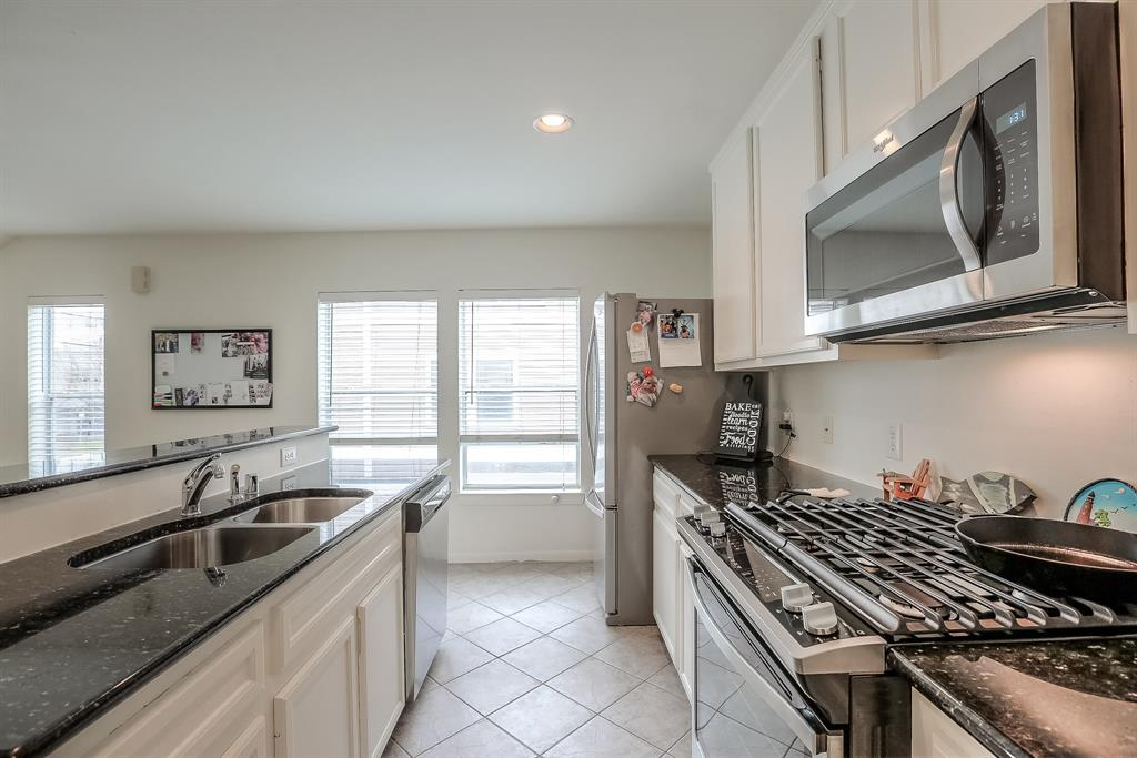 The family chef will love the new stainless steel appliances and gas range.