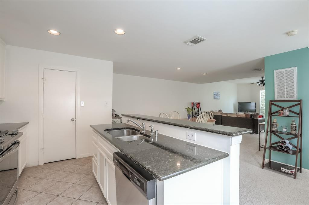 The kitchen opens to the dining space and living room which makes a great space for entertaining.