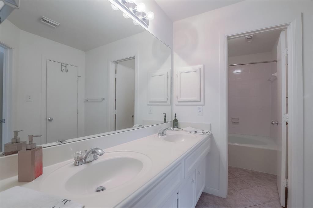 Master bath features dual vanities.