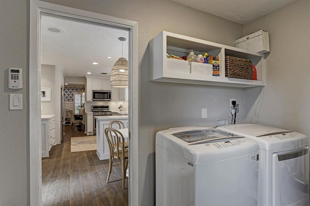 Laundry room features built in mudroom cabinets as well as cabinet above washer and dryer for storage.