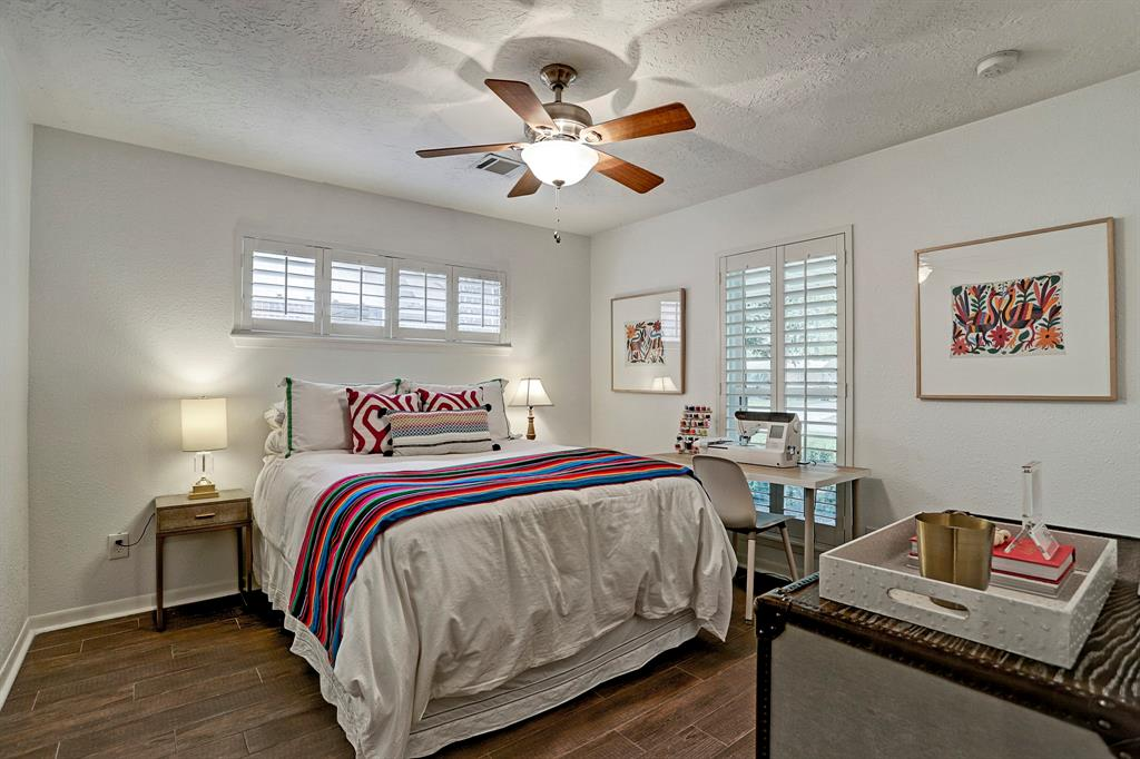 Good sized front bedroom features two windows and a good sized closet with built in drawers.