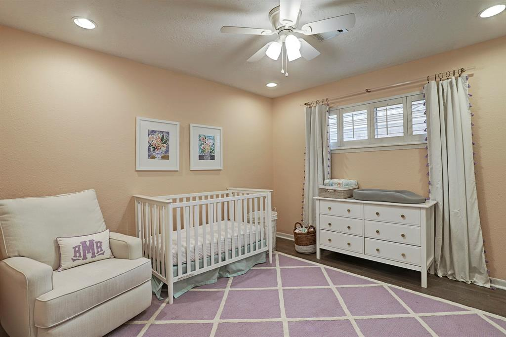 Middle bedroom currently used as a nursery. New ceiling fan and nice sized closet with built in drawers.