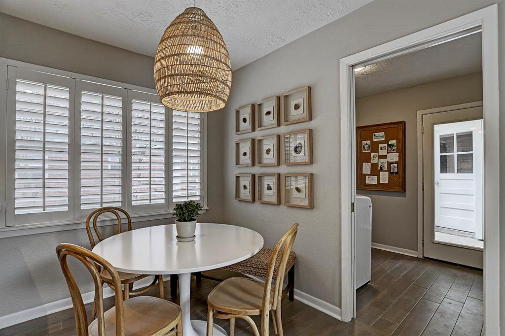 Lots of natural light in the breakfast nook. Pocket door leads to laundry room.
