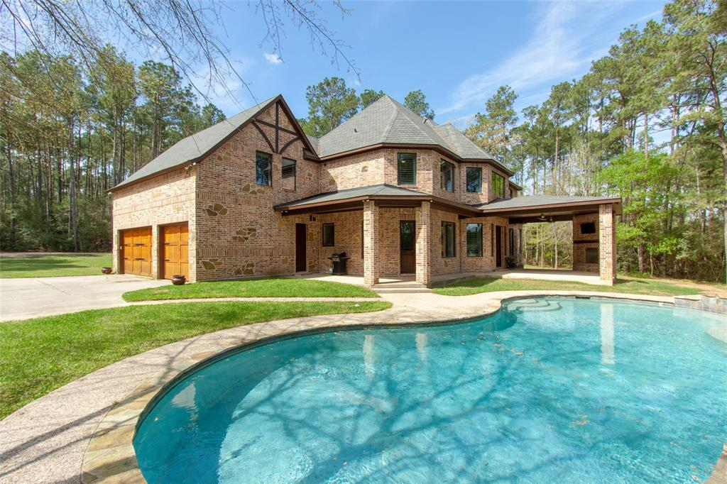 Lake House on private 3.29 acres! Gently lived in 3,886 sf custom home with 1,983 sf guest house, workshop, pool & pier/boat dock on Indigo Lake! Beyond the gated entry & wooded drive, your private retreat awaits! Nothing was spared in this truly custom home. The 1st floor features hotel inspired private master retreat, 2-story family room, chef's kitchen, large mud room, study, half bath & hidden Christmas closet. Upstairs you'll find 2 full baths, 3 bedrooms & well-designed mancave or family retreat with hidden spiral staircase leading to oversized 3 car garage. An outdoor fireplace completes the large covered patio off the family room overlooking the backyard oasis/pool, pier/boat dock & lake. Spacious guest home is ideal for your extended family, caretaker or guests with 4 bdrms, 2 baths, laundry, kitchen w/ bar, 2-story family room plus private porch overlooking the lake. 41x18 workshop with 12x12 roll up door can house your RV, ATVs or projects, currently used for batting cage.