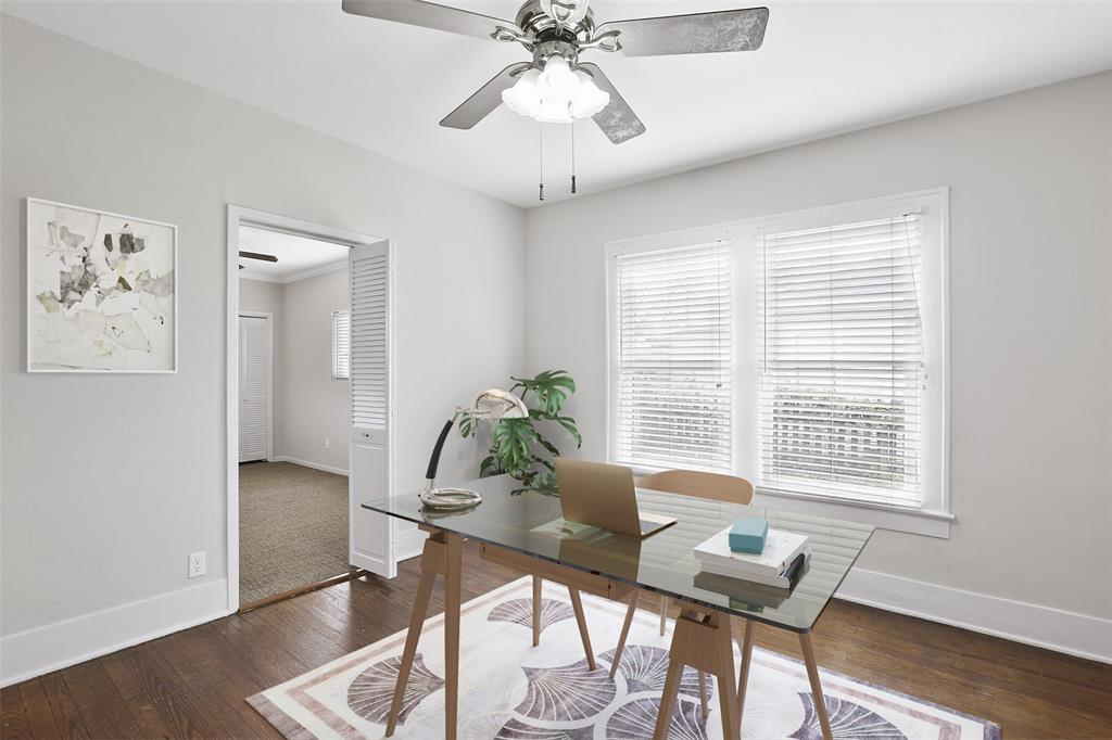 Lots of natural light in this secondary bedroom. Also includes hardwood floors and ceiling fan. This image has been virtually staged to provide you with a possible lay out of this great bedroom.