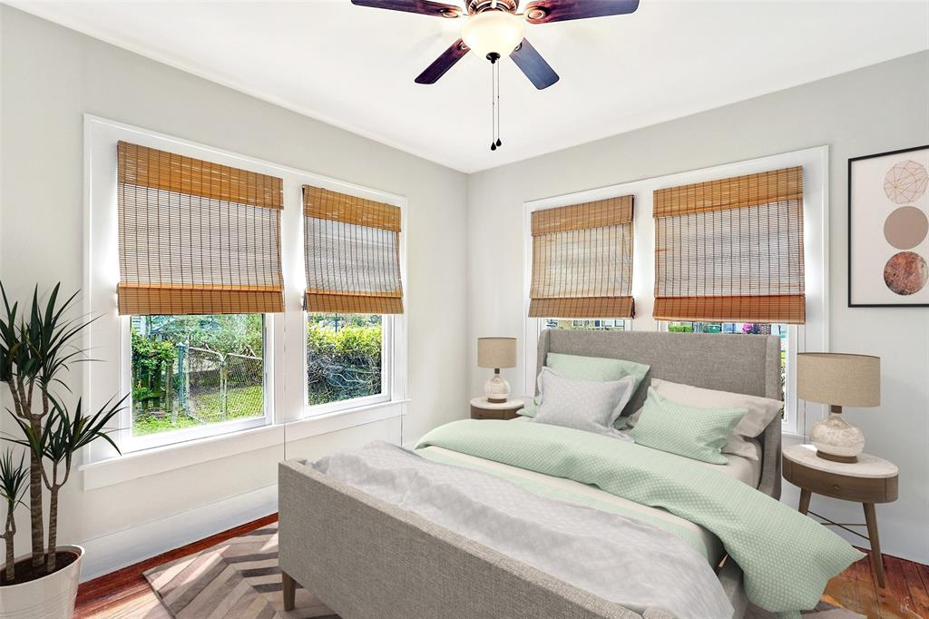 Front bedroom also includes the hardwood floors, a ceiling fan, and tons of natural light. Either of the secondary bedrooms could double as a study or guest bedroom.