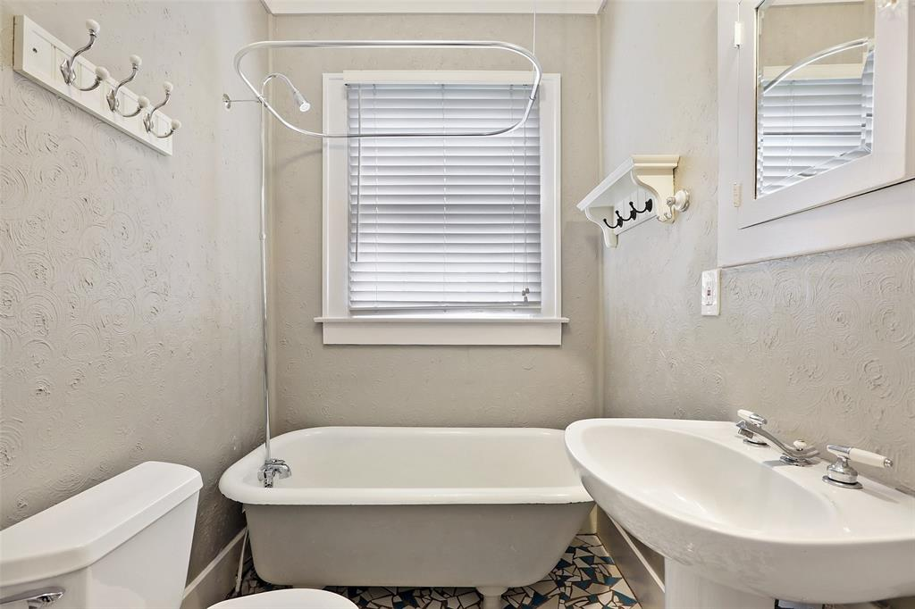 Master bath has freestanding tub/shower.  It also includes a beautiful mosaic tile floor.