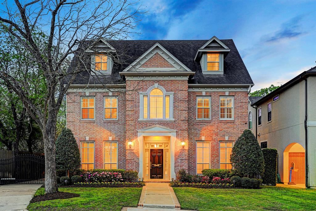 Stately brick & stone home in sought after Bellaire on cul-de-sac street, 4 bedroom 4 full/2 half bath home, grand dining w/built-in buffet & large study off entry, engineered hardwoods (2017) through to family room w/box ceiling design,  built-ins/decorative shelving, wet bar & wall of windows w/views of the sparkling pool/spa/water features makes for an amazing space to gather,  remodeled kitchen w/Statuary Marble counters, Thermador ovens, Bosch dishwasher & designer backsplash (2016), entry stairs lead to oversized master bedroom retreat w/sitting room & 2nd fireplace, his & hers custom closets, jetted tub & glass shower, 3 spacious secondary bedrooms, 1 ensuite, 2 share a Jack & Jill bath, 3rd floor flex room for expanding family space w/built-ins & half bath, wonderful separate garage apartment & bath, not included in square feet, Zoned to Condit , Pin Oak/Pershing Middle, Bellaire High, Convenient to Downtown, Galleria & Texas Medical Center, Come see this exceptional home!