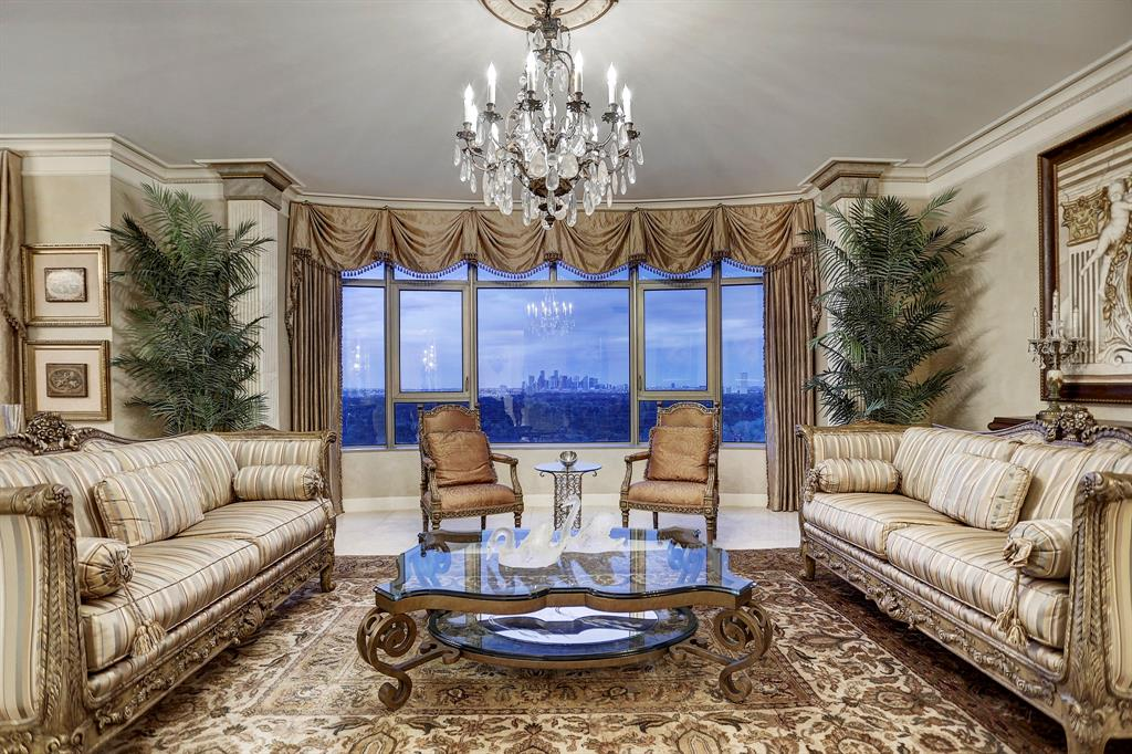 Stunning downtown views & high end custom finishes throughout. Newly renovated 1 bedroom unit at the fabulous Villa D'este. 2,390 square feet of luxurious and highly customized living spaces. Elegant entry, formals, bar with wine refrigerator perfect for entertaining. Expansive kitchen with breakfast room open to den w/ custom electric fireplace. Hand painted walls & ceilings, ornate trim, polished marble floors, open layout and Bose surround sound throughout. Immaculately maintained w/wonderful storage. 2 Reserved Parking Spaces. Building amenities include 24-hour concierge, valet parking, fitness center, tennis courts and swimming pool. Walking distance to restaurants and elite shops at Uptown Park.