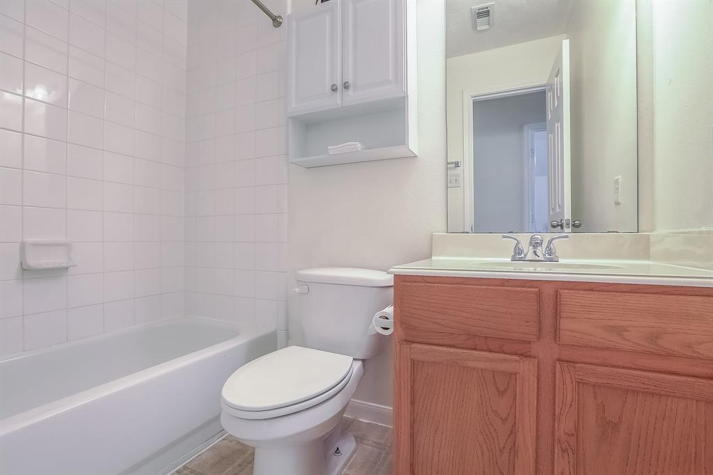 Full bath upstairs between bedroom 1 and 2. Room for storage.