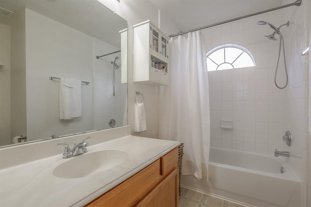 Bright, clean master bathroom is waiting for your personal touches.