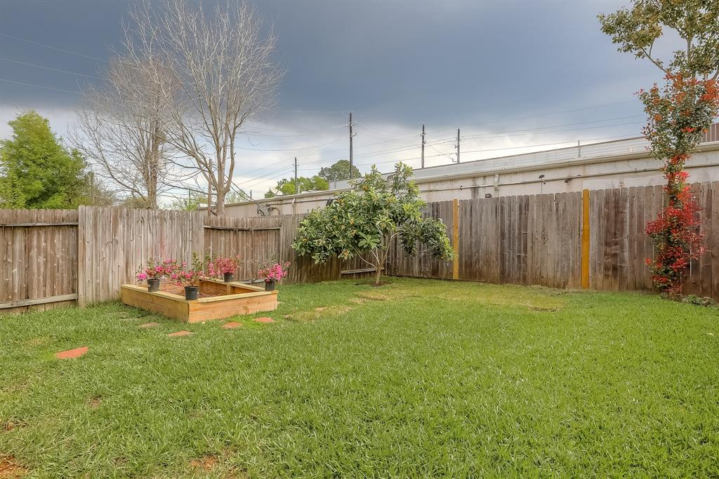 Privacy created by fence all around the back yard. This yard is your canvas for whatever you want to create with it.
