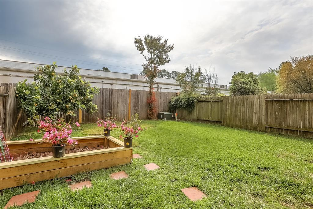 Another view of spacious back yard. Raised beds all around? Hot tub? Pergola? Playground? Make this yard your own.