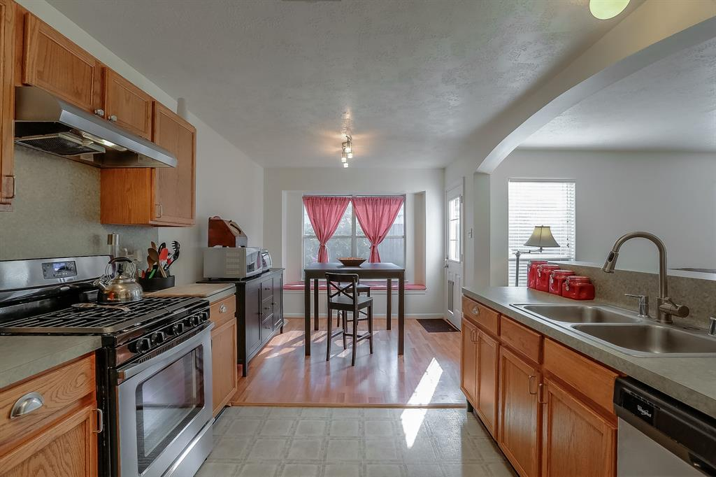 SS gas range, SS dishwasher bring beauty to this kitchen!