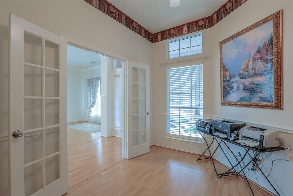French doors in Office lead to the Entry Way / Living Room.