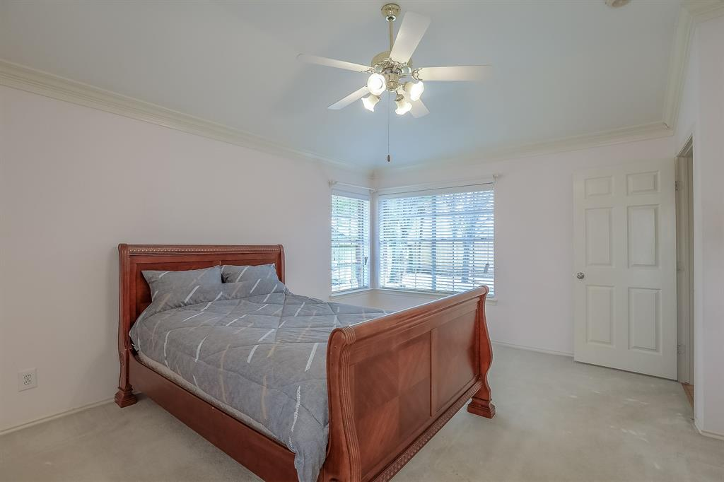 Master Bedroom also features crown molding.