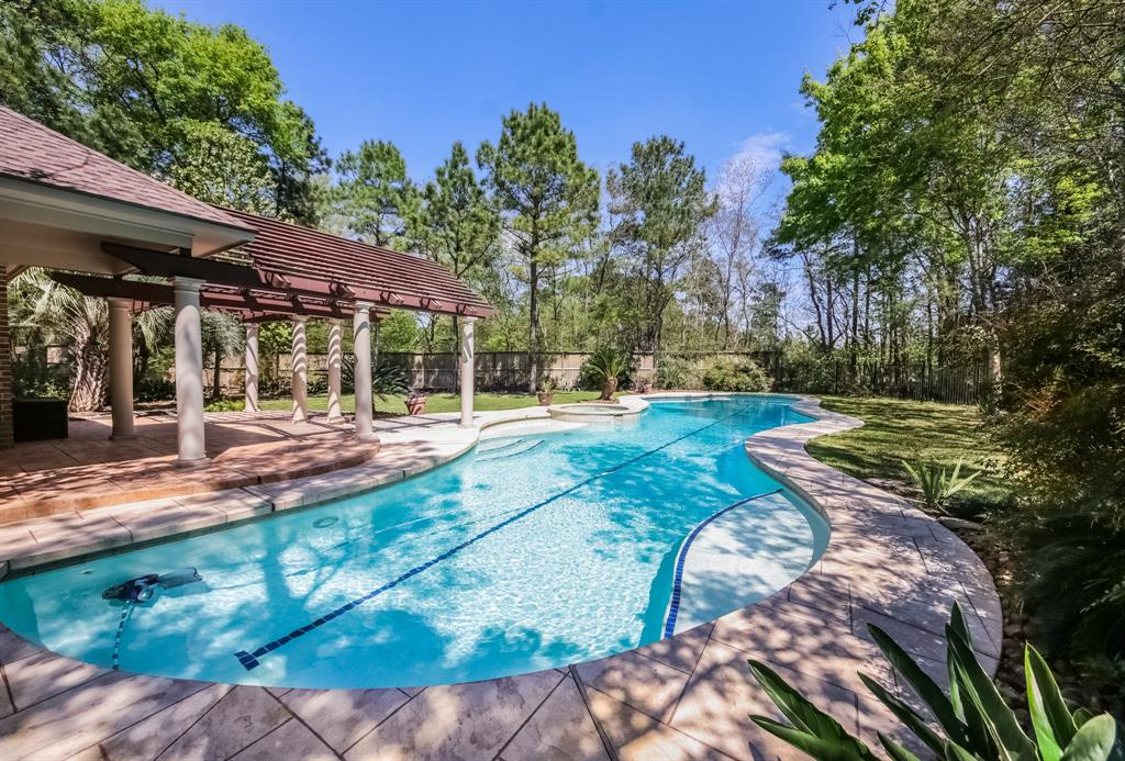 6 / 4-1/2 / 3 -- This exceptional home sits on over a 1/3 acre, privately secluded in cul-de-sac with lots of trees and next to a permanent forested reserve.  A sparkly oversized pool extending 75' in length for avid swimmers. There are 2 bedrooms down - the master & a guest suite or mother-in-law quarters.  Game room and 4 Bedrooms & 2 full baths up.  Roof is fairly new within the last few years.  The kitchen was completely renovated a couple of years back with a rare granite and commercial grade appliances, a soap stone sink with picturesque windows overlooking a resort size backyard with a large expanded patio, adorned with marble columns & an engineered pergola. Master Bath was also recently updated with new cabinets and designer sinks.  Also includes whole house tankless on-demand H20 water. heater. Closets organized by Closet Maid.  Also, under a pest control contract, which is transferable.  A wonderful storage shed for pool & yard supplies.  This is a MUST SEE.