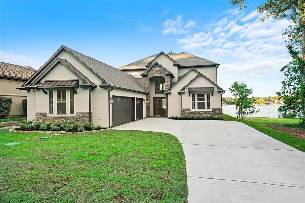 "Only brand new construction available for sale on Lake Conroe that is on ""open water""! 5275sq ft, 4/5 bedroom, 4.5 bath home with study, formal dining, breakfast room, game room, media room, large utility room & oversize 3 car garage with coated floors.. Heated swimming pool & spa with fire-pit in pool deck, Huge covered patio & balcony areas to enjoy the preferred Northeast exposure views from, & an outdoor kitchen for BBQ's. Large half acre + lot with plenty of grass area left over in addition to swimming pool area. Open floor-plan with hardwood plank tile flooring throughout the entire down stairs living area along with hardwood flooring on the staircase. Fabulous kitchen is open to the living area and has a large island, tons of site-built custom cabinets, double ovens, gas cooktop, drawer microwave, full size fridge & freezer, and most important, fabulous views looking out across Lake Conroe. Huge secondary bedrooms with large closets & lots of storage throughout home. Must see..."
