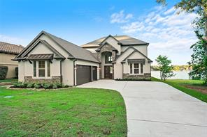Brand new 5275 sq ft custom home with desired Northeast facing open views of Lake Conroe! Home is located towards the end of a quiet culdesac on a half acre+ lot, and is fully landscaped with auto sprinklers. Aesthetically pleasing stone & stucco exterior and a large 3 car garage add to the over-all appeal of the property.