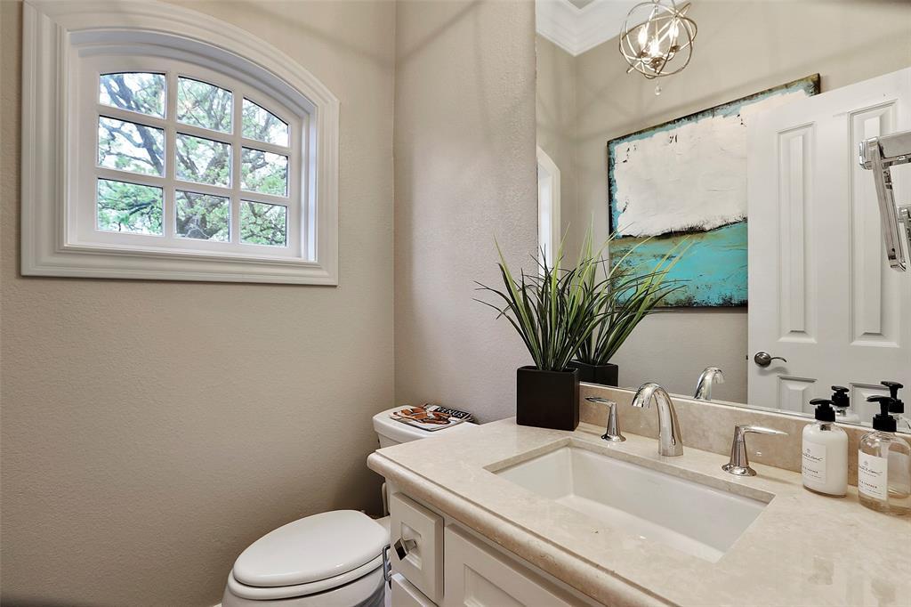 The half bath on the second floor is convenient for guests and entertaining.