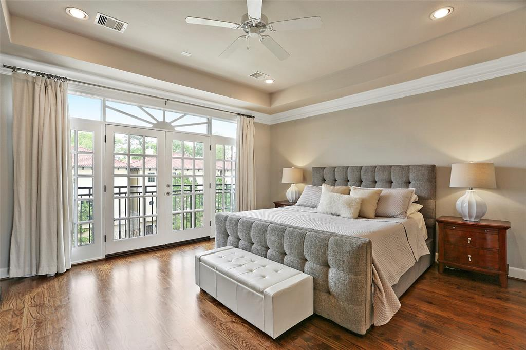 Spacious master suite features wood floors, recessed ceiling and lights, crown molding and two large walk-in closets with built-in storage.