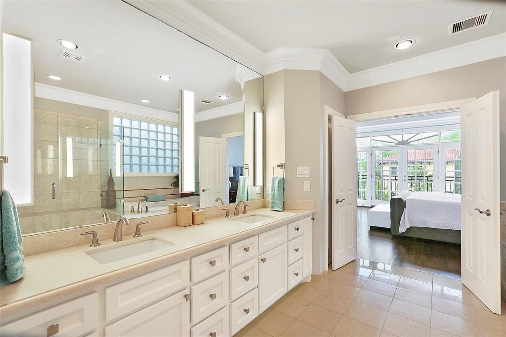 The luxurious master bath is a great space to start your day.  The dual vanities feature lots of storage and upgraded LED light fixtures.