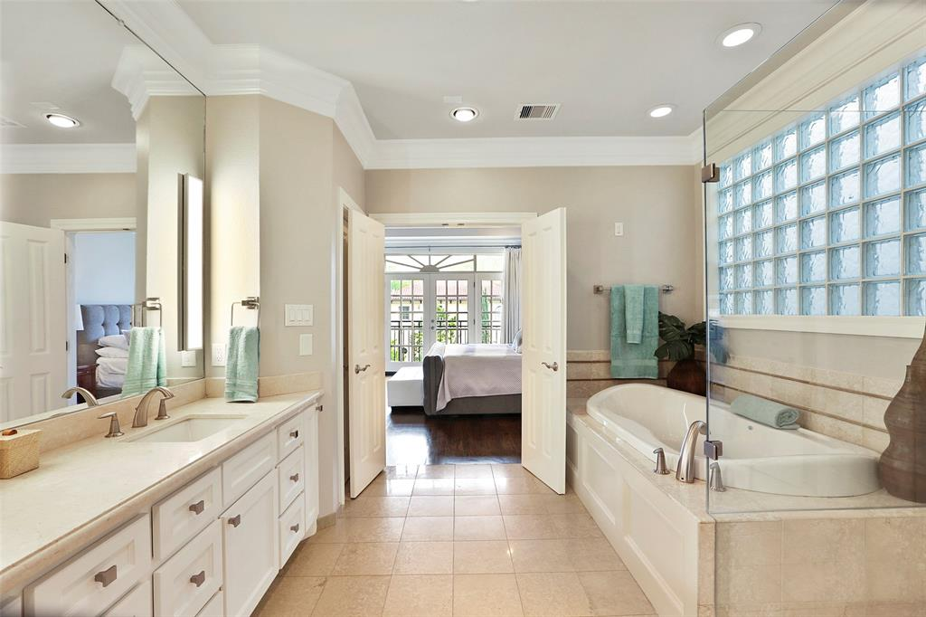 The master bath also features an over-sized, jetted, tub with tile surround which creates a spa-like feel.