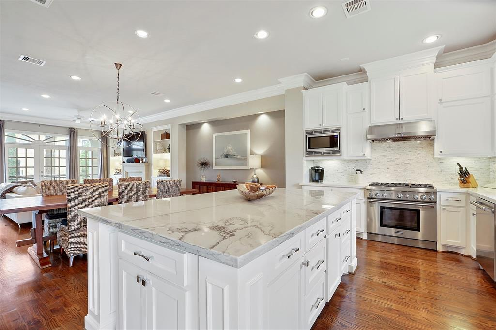 The family chef will enjoy entertaining and cooking on the Thermador gas range.  The kitchen also features tons of storage and upgraded tile back splash with LED under cabinet lighting.