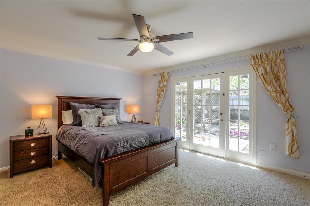 Spacious and bright master suite features two walk-in closets and new ceiling fan.