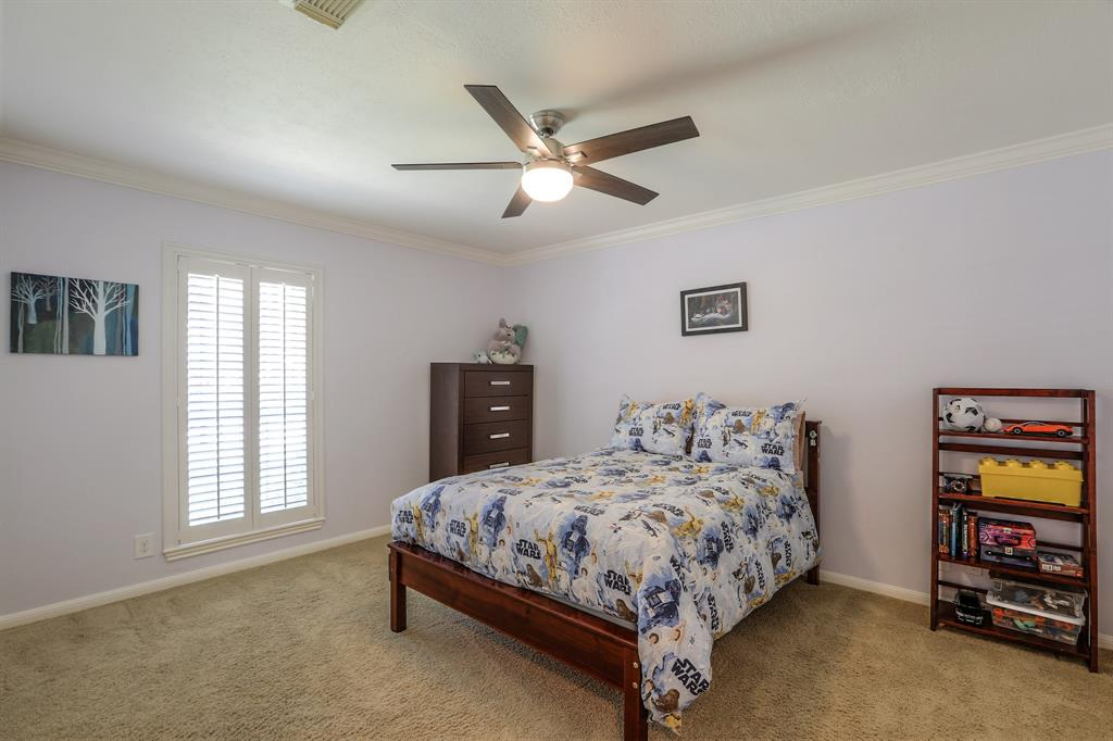 Bedroom # 2 with new interior paint, crown molding, new ceiling fan and new closet storage.
