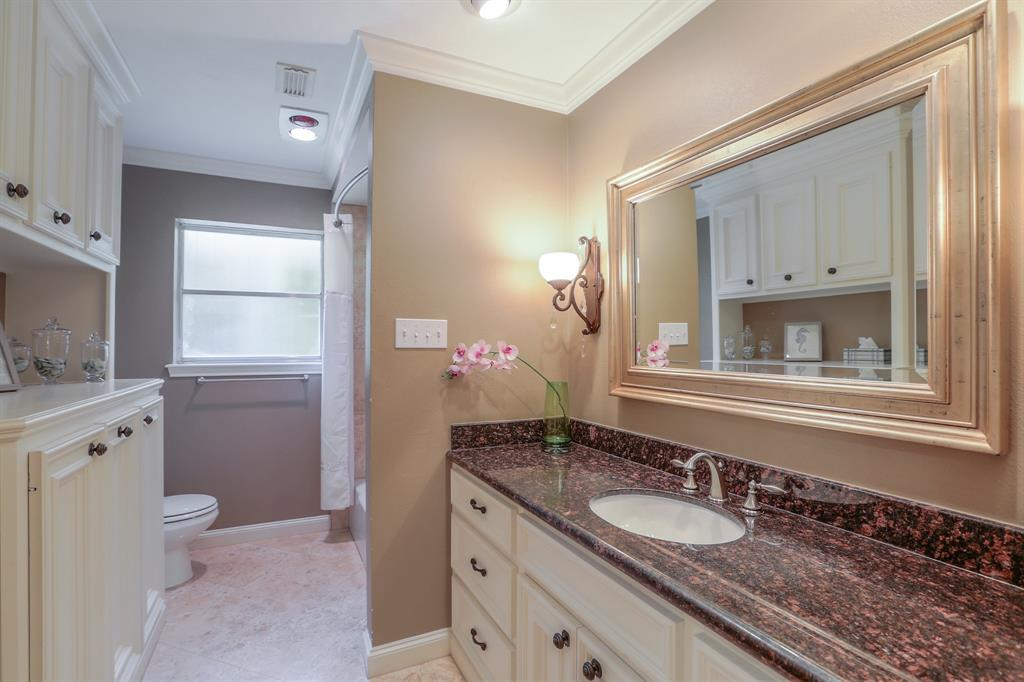 Updated full bath # 2 with granite counter top and lots of storage.