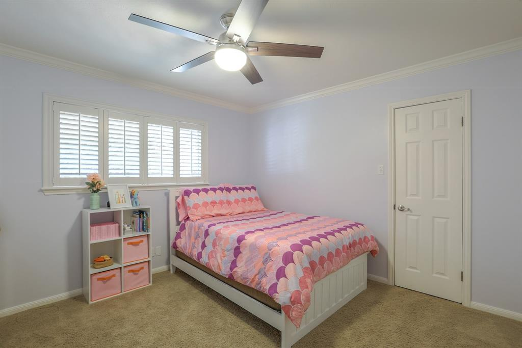 Bedroom # 3 with new interior paint, new ceiling fan, crown molding and new closet storage.