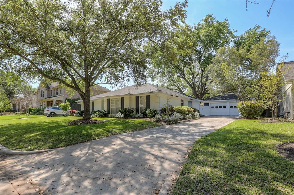 This home features mature landscaping and a 2-car garage with bonus workshop space.