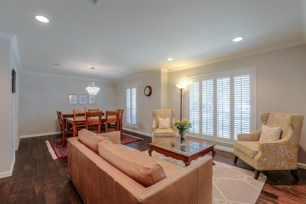 This classic ranch-style home layout features a formal living room that's open to the dining space which includes new wood floors, crown molding and recessed lights.
