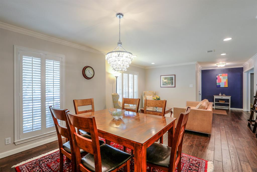 The dining space can easily fit a six or eight person dining table and also features an updated chandelier.