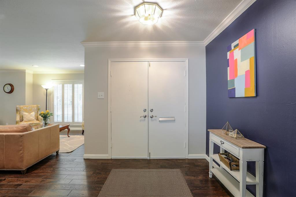 Spacious entry that opens to the formal living room and family room.