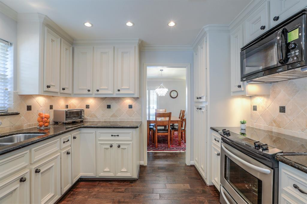 The kitchen features stainless steel appliances and granite counter tops.