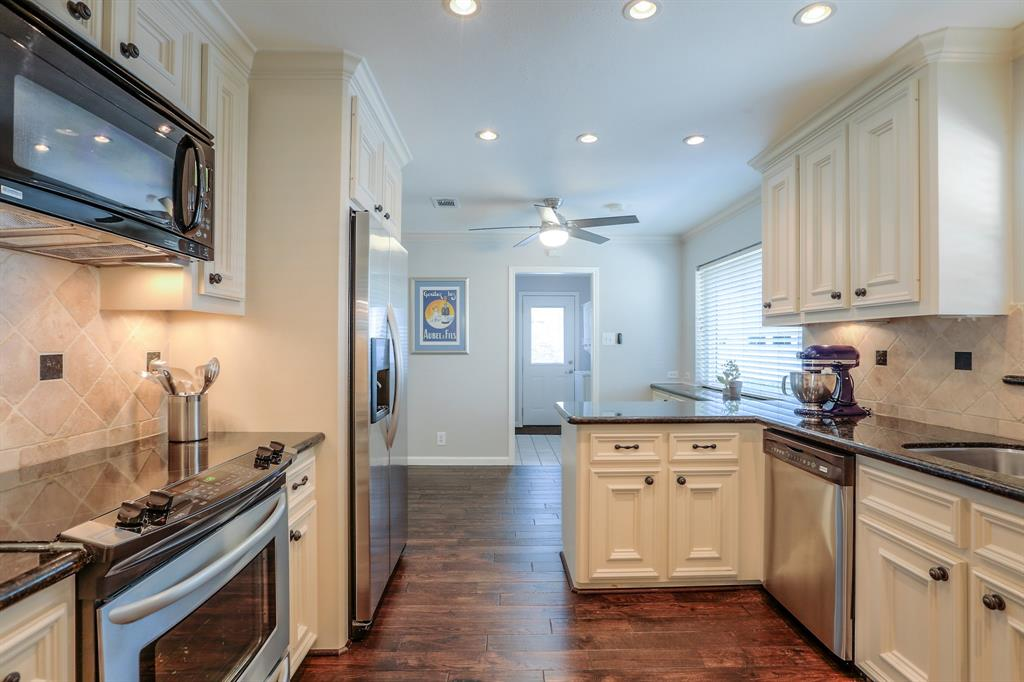 The family chef will love cooking and entertaining in this spacious updated kitchen.