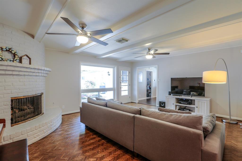 The family room features refinished wood floors, new sheet rock and new ceiling fans.