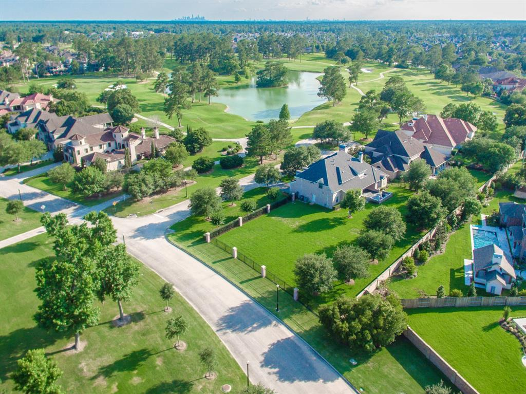 """Also available for purchase is 14,017 sq ft lot attached to property. Fabulous opportunity to live in one of the finest gated communities in the Houston area. This gorgeous Jaeger custom home on a quiet cul-de-sac street offers great views of the famous """"Golf Club of Houston""""plus lake views & mature oak trees on the property. Located off Beltway 8 & Hwy 69 for easy access to IAH airport & just minutes away from all Houston has to offer! Yard is surrounded by elegant brick and iron fencing. This home has it all... game room with a tea balcony, gorgeous study w/golf course views, large media room ready for movie night. The gracious Master bedroom Suite has a covered outdoor patio area to relax & enjoy the golf course views. Stunning kitchen w/granite counters & top of the line stainless appliances. Outdoor patio & kitchen is a great space for entertaining! Please see the 3D Virtual Tour where you can take a walking tour in order to virtually enter specific areas of this gorgeous home!"""