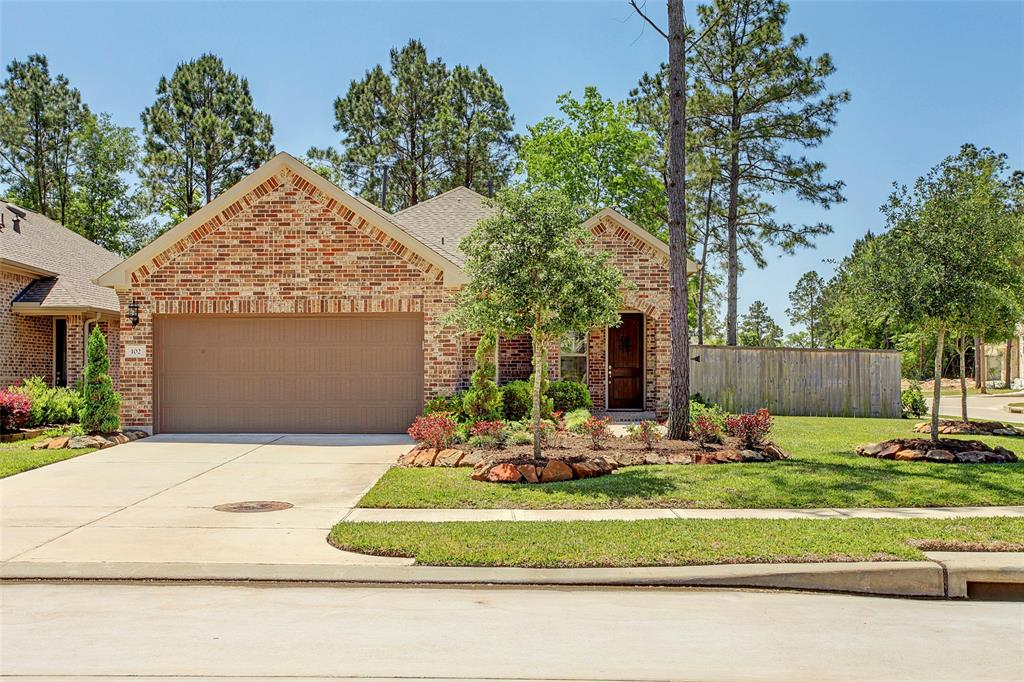 """New home cannot be built for this price in tranquil 55+ golf course community with almost every aspect of home boasting upgrades that include beautiful level 5 tile designed to reduce slipping, 42"""" abundant cabinetry, level 4 granite countertops, level 4 backsplash, remarkable master suite with amazing bath, huge extended covered patio & rare, large, beautifully landscaped backyard! Absolutely gorgeous and immaculately maintained, this fine home features an open floor plan, cozy ledgstone fireplace, stainless-steel appliances and expansive windows that make it light, cheery & bright. Situated on a corner lot, the home provides privacy and plenty of green space for those who enjoy being outdoors. Energy-efficient home offers radiant barrier, double-pane windows, high-efficiency HVAC, attic fans. Community amenities include Woodforest Golf Club featuring beautiful 27-hole course, club house with activities galore, pool, splash pad and more! Home is better than new & extraordinary!"""